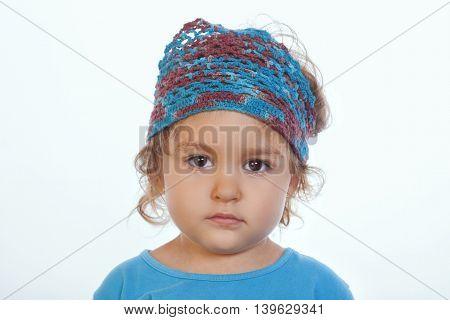 Adorable Calm Girl Looking At Camera And Wearing Blue Handmade Headband