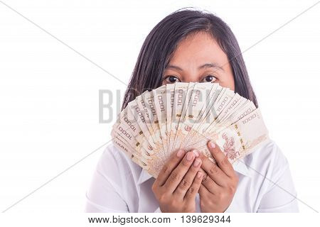Woman holding Thai money hide her face isolated on white background