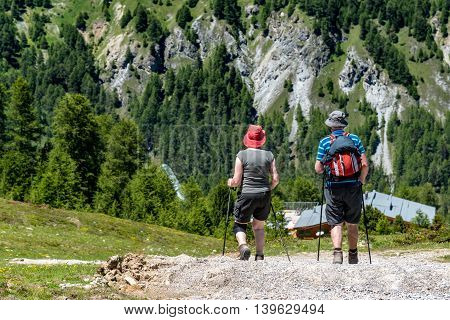 Tourists Climbing In Alps