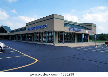 SHOREWOOD, ILLINOIS / UNITED STATES - AUGUST 30, 2015: One may exercise at Charter Fitness, in a Shorewood strip mall.