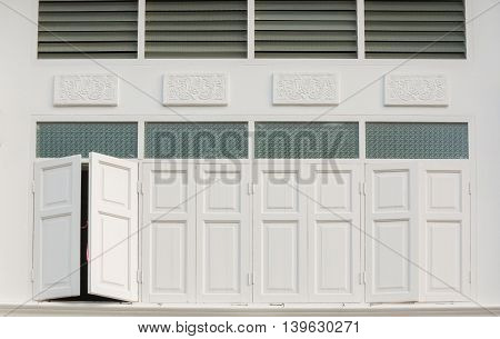 Rows of old wooden white windows in vintage style white background