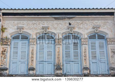 Old architectural element Blue retro window background.