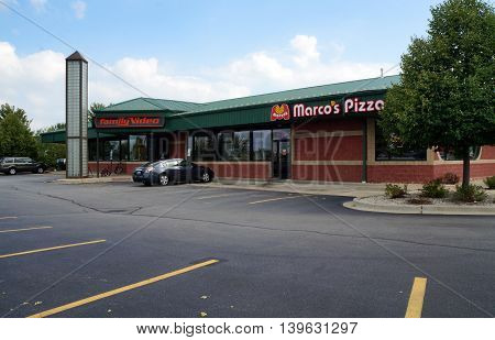 SHOREWOOD, ILLINOIS / UNITED STATES - AUGUST 30, 2015: One may rent movies at Family Video, and eat pizza at Marco's Pizza restaurant, in Shorewood, Illinois.