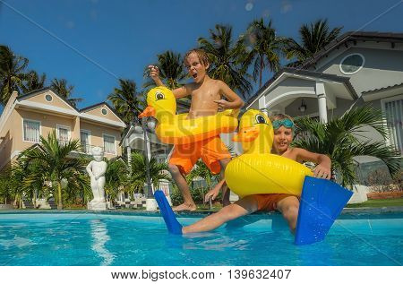 Two little boys in the swimming pool