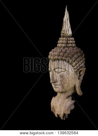 Ancient cracked and burned wooden Buddha statue head isolate on black background with clipping path