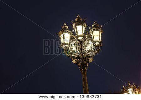 old iluminated lantern by night in Frankfurt