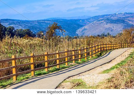 Fenced path in the park of  Lake Hula. Hula Nature Reserve, Israel, December