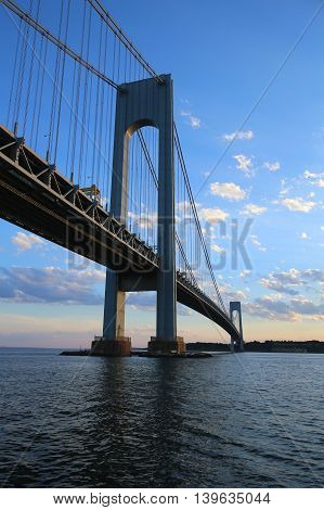 NEW YORK - JULY 23, 2016: Verrazano Bridge at dusk in New York.The Verrazano Bridge is a double-decked suspension bridge that connects the boroughs of Staten Island and Brooklyn