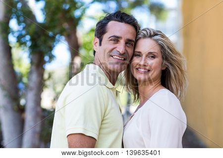Portrait of happy couple standing on street