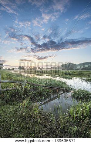 Beautiful Vibrant Summer Sunrise Over English Countryside Landscape