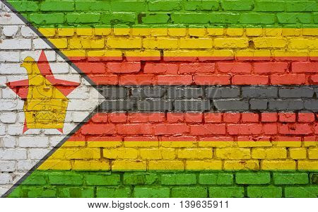 Flag of Zimbabwe painted on brick wall background texture