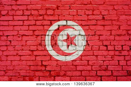 Flag of Tunisia painted on brick wall background texture