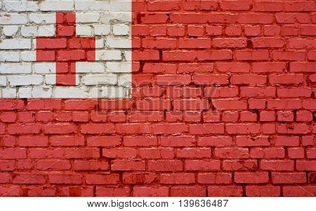 Flag of Tonga painted on brick wall background texture