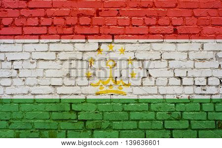 Flag of Tajikistan painted on brick wall background texture