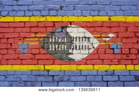 Flag of Swaziland painted on brick wall background texture