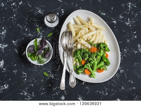 Pasta with broccoli. Delicious healthy vegetarian lunch. On a dark background