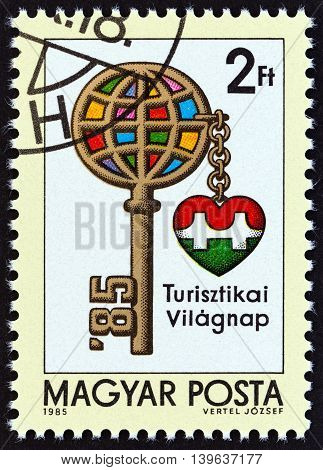 HUNGARY - CIRCA 1985: A stamp printed in Hungary issued for the International Tourism Day shows Key with Globe as Head, circa 1985.
