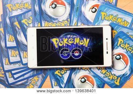 Kuala Lumpur,Malaysia 23th July 2016, smartphone with pokemon go logo on the screen on top of pokemon card