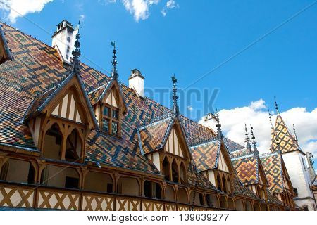 famous hospice in Beaune France under blue sky