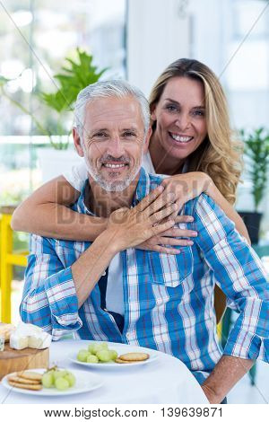 Portrait of happy mature couple in restaurant