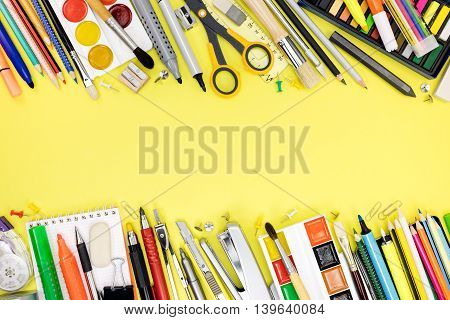 School And Office Supplies For Studies On Yellow Background