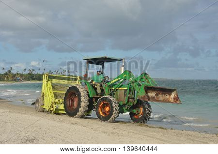 ST LUCIA CARIBBEAN 17 January 2015: Surf rake on tractor