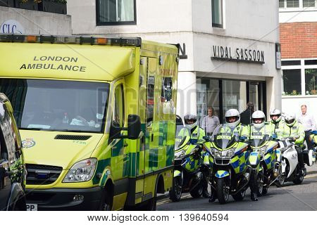 CITY OF LONDON ENGLAND 13 March 2015: Police Motorcyclists and Ambulance
