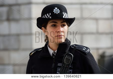 CITY OF LONDON ENGLAND 13 March 2015: Metropolitan Policewoman on duty