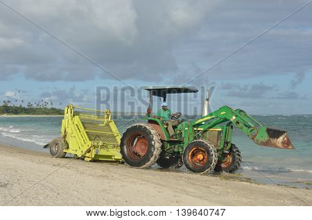 ST LUCIA CARIBBEAN 17 January 2015: Green surf rake on tractor
