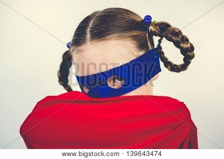 Portrait of girl pretending to be a superhero
