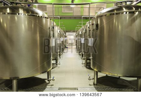Alley tanks of stainless steel in the shop. The food industry, beer production.