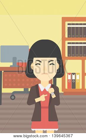 An asian  angry business woman standing in the office and pointing at her wrist watch. Vector flat design illustration. Vertical layout.
