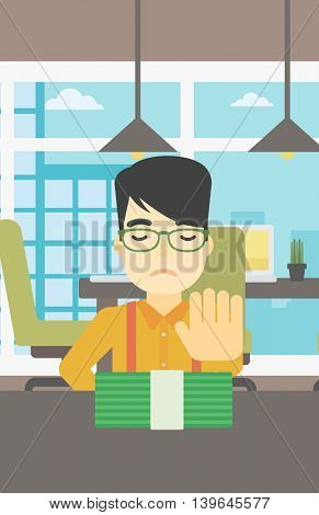 An asian  young businessman sitting at the table in office and moving dollar bills away. Vector flat design illustration. Vertical layout.
