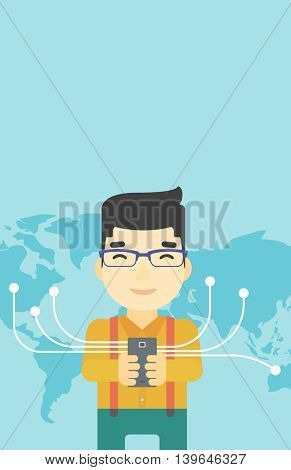 An asian  young businessman holding smartphone connected with the whole world. Concept of global business. Vector flat design illustration. Vertical layout.