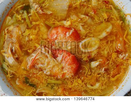 boiled seafood with spicy egg soup in bowl