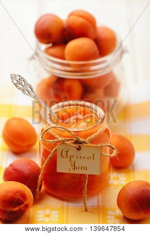 Apricot jam in glass jar. Selective focus.