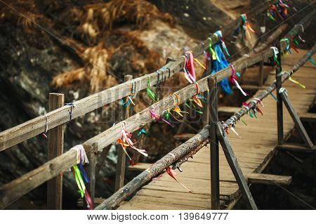 Wooden Bridge Above Mountain River In Autumn