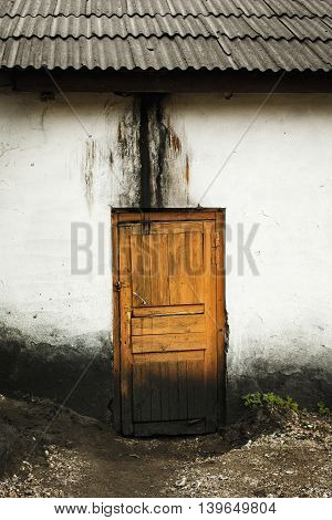 Old abandoned house with wooden dirty door