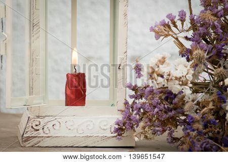 lantern with candle and flowers in vintage style