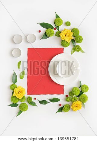 Paper, Candles And Cup For Coffee Or Tea With Wreath Frame From Flowers.