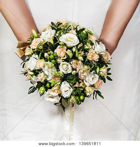 Bouquet Of Roses In Hands Of Bride In White Dress.