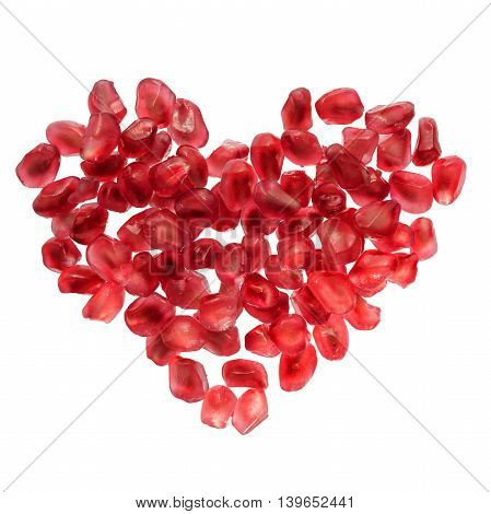 Heart shaped pomegranate seeds isolated on white. Love passion symbol. Valentines day super food concept
