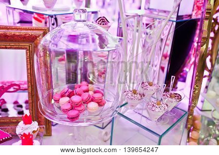 Awesome Wedding Reception Of Food And Drink With Various Pink Light, Macaroon