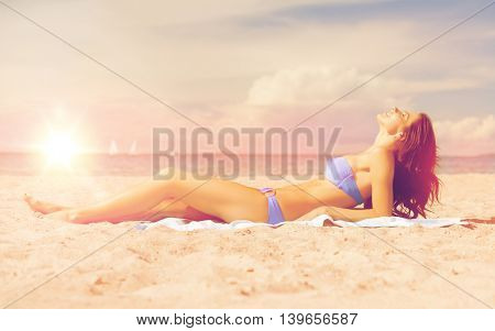 picture of young woman lying on the beach.