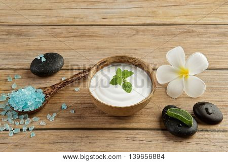 Spa Setting Concept With Blue Salt Sea In Spoon, Mint On Top Of White Cream In Coconut Shell, Piece