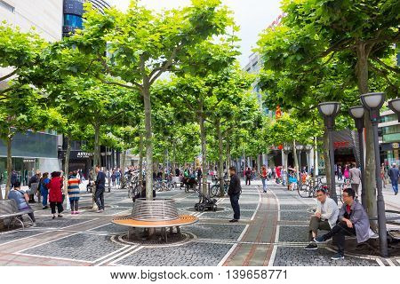 Frankfurt, Germany - June 15, 2016: people walk along the Zeil in Midday in Frankfurt, Germany. Since the 19th century it is of the most famous and busiest shopping streets in Germany.