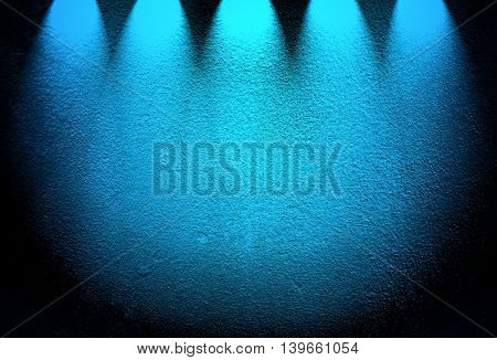 blue concrete wall with spotlight background