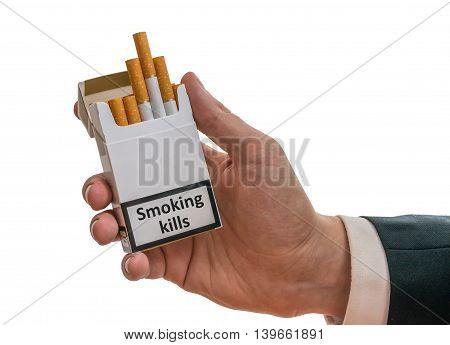 Man Holds Cigarette Pack In Hand With Warning Label That Smoking