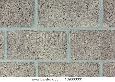 brickwork, background and texture concept - gray brick wall backdrop
