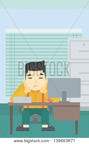 A tired asian tired businessman sitting at workplace in front of computer monitor and clutching his head. Vector flat design illustration. Vertical layout.